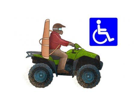 En jägare kör en terränghjuling.